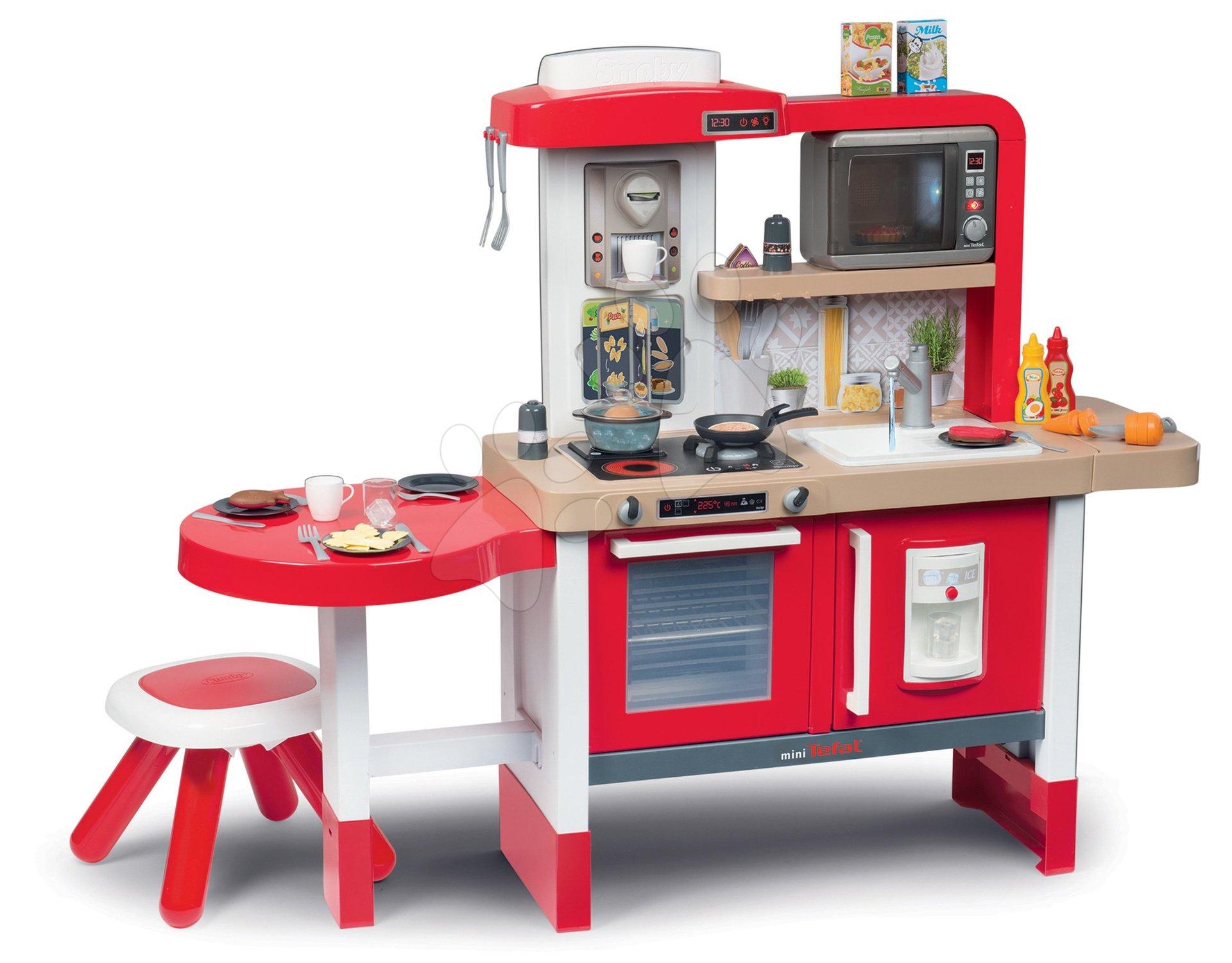 Elektronické kuchynky - Kuchynka rastúca s tečúcou vodou a mikrovlnkou Tefal Evolutive Gourment Smoby červená s magickým bublaním stoličkou a 43 doplnkov