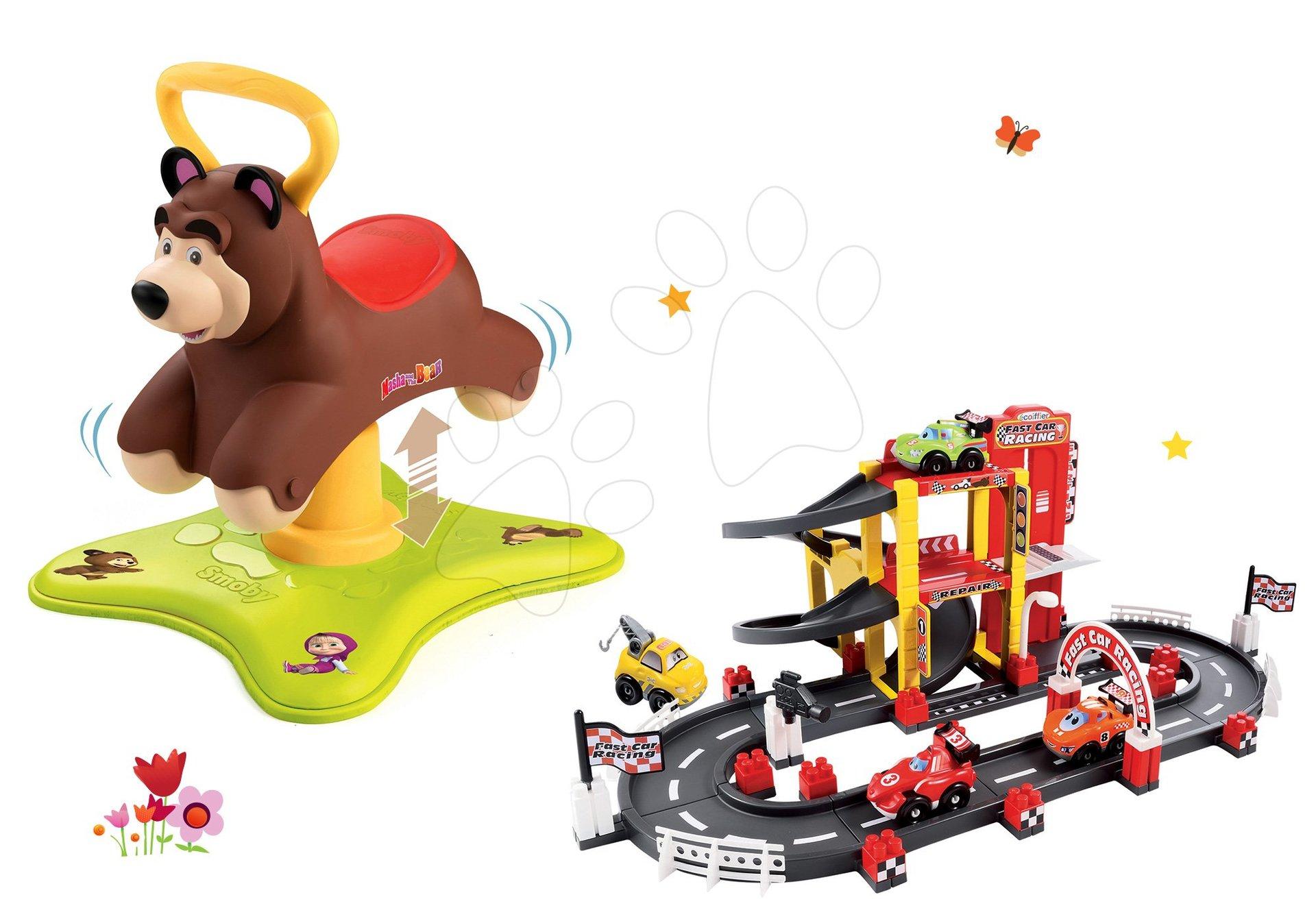 Set babytaxiu Ursuleţ 2in1 Smoby săltăreţ şi rotitor şi jucărie de construit Garaj F1 de la 12 luni