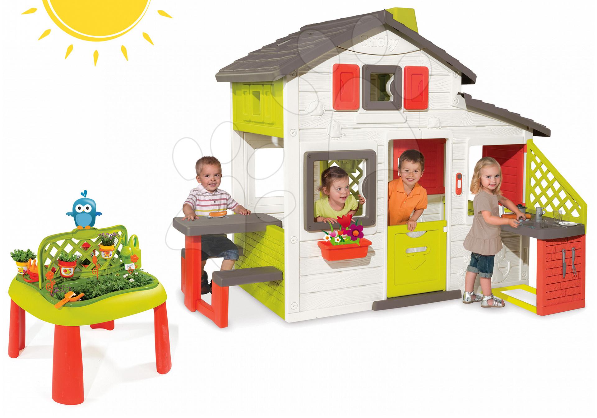 Set căsuţă Prieteni Smoby cu bucătărie, sonerie şi măsuţă Grădinar De Jardinage de la 3 ani