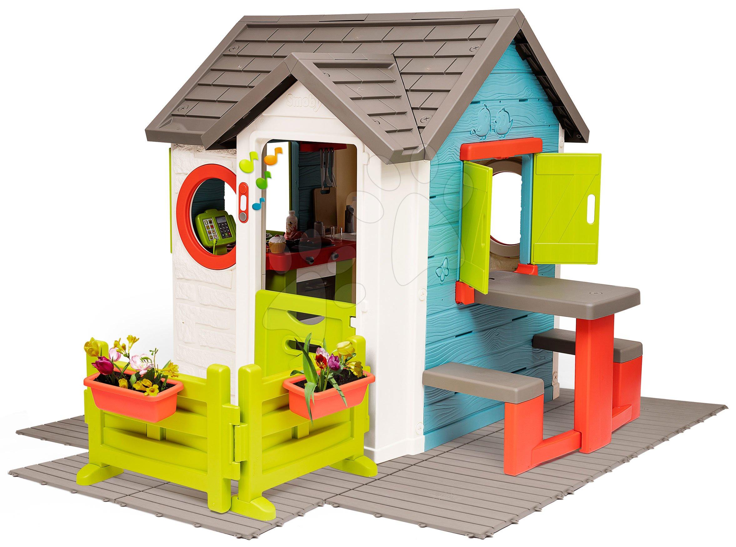 Căsuță cu restaurant de grădină Chef House DeLuxe Smoby cu măsuță și grădină pe pardosea