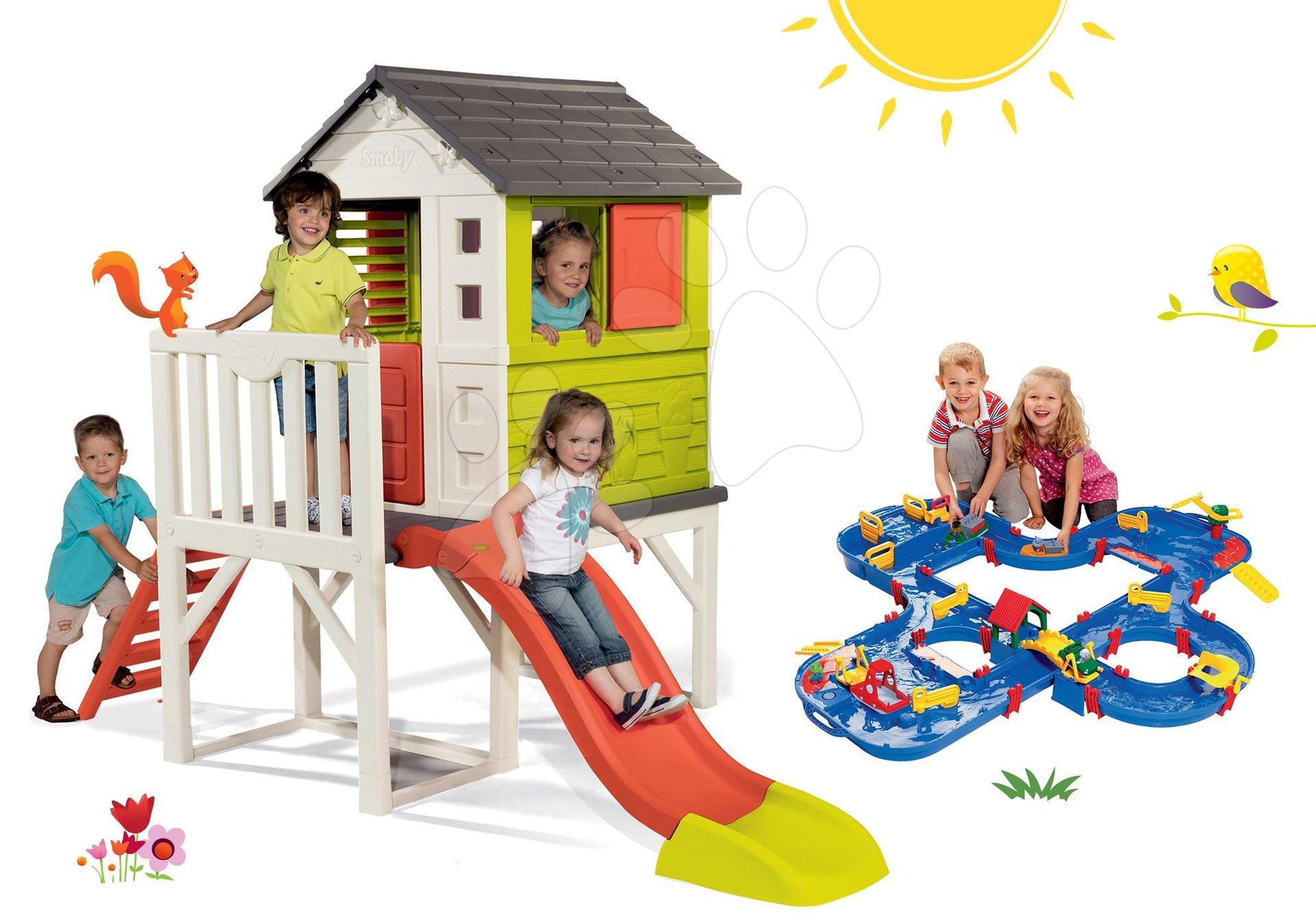 Szett házikó pilléreken Pilings House Smoby 1,5 m csúszdával és vízi pálya Aquaplay 'n Go bőröndben gáttal 24 hó-tól