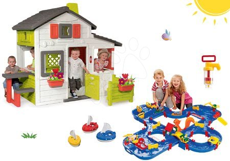 Komplet hišica Prijateljev Smoby s predhišnim vrtom in vodna steza Aquaplay 'n Go v kovčku z jezom in 3 ladjicami ter črpalko