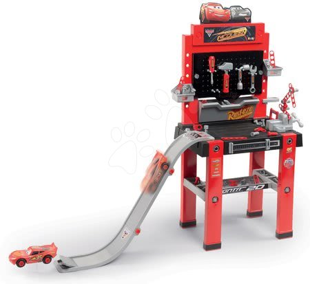 Atelier de lucru Maşini 3 Bricolo center Smoby cu pistă pentru sărit, cu maşinuţă asamblabilă şi cu 94 de accesorii