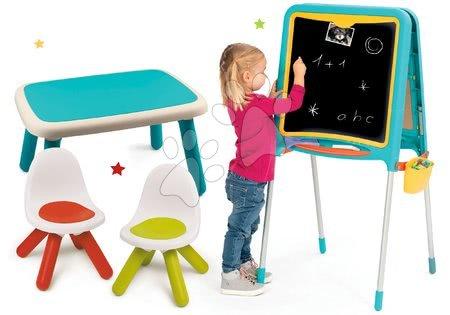 Set tabuľa na kreslenie a magnetky Metal Board Smoby obojstranná a stôl s dvoma stoličkami Kid