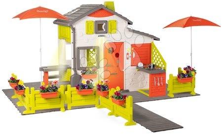 Házikó Neo Friends House DeLuxe Smoby virágos felvezető úttal és két napernyővel