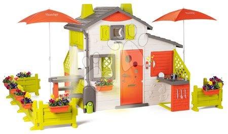 Smoby - Domeček Neo Friends House DeLuxe Smoby se dvěma kuchyňkami a stolky se slunečníkem s oplocením