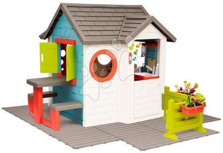 Domečky pro děti - Domeček se zahradní restaurací Chef House DeLuxe Smoby na podlaze se stolem a zahrádkou
