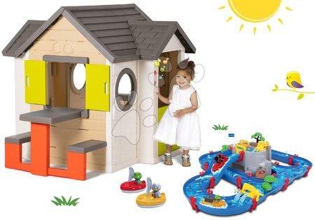 Set domček My Neo House DeLuxe Smoby so zvončekom stolíkom a vodná dráha s horskou jaskyňou priehradou a 2 loďky od 24 mes