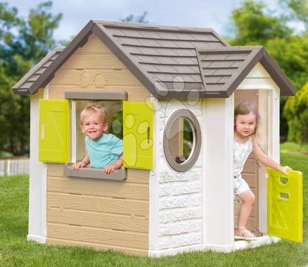 Căsuță bej My New House Smoby extensibilă cu 2 geamuri cu obloane și 2 geamuri rotunde și ușă mică 135 cm înălțime cu filtru anti UV de la 2 ani