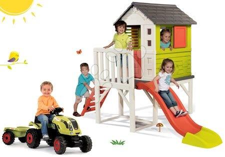 Claas - Set domeček na pilířích Pilings House Smoby s 1,5 m skluzavkou a traktor na šlapání Claas Farmer XL s přívěsem od 24 měsíců