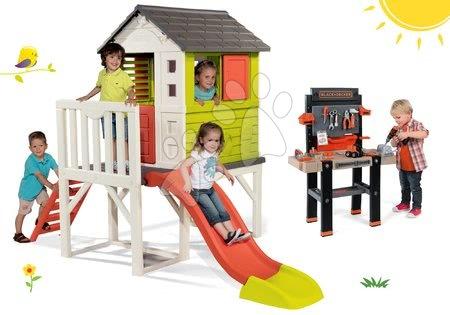 Hračky pre chlapcov - Set domček na pilieroch Pilings House Smoby s 1,5 m šmykľavkou a pracovná dielňa Black+Decker elektronická s vŕtačkou
