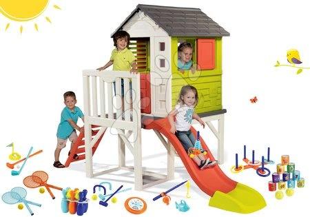 Jucării pentru fetițe - Set căsuţă pe piloni Pilings House Smoby cu tobogan de 1,5 m și set de sport cu piramidă din cutii de conserve şi popice de la 24 luni