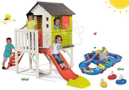 Hračky pre chlapcov - Set domček na pilieroch Pilings House Smoby s 1,5 m šmykľavkou a vodná dráha Aquaplay Mountain Lake s jaskyňou s 3 loďkami