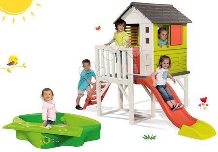 Jucării pentru fetițe - Set căsuţă pe piloni Pilings House Smoby cu tobogan de 1,5 m și nisipar cu capac de protecție și pistă de apă 138 cm de la 24 de luni