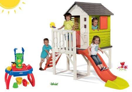 Set căsuţă pe piloni Pilings House Smoby cu tobogan și nisipar cu măsuță pentru apă şi nisip de la 24 luni