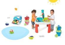Set stôl pre deti Voda&Piesok 2v1 Smoby s mlynom, vedro set s krhlou priesvitné modré/červené a 3 kusy mini čln od 18 mesiacov