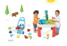Set stôl pre deti Voda&Piesok 2v1 Smoby s mlynom, otvorom na slnečník a vozík na ťahanie s vedro setom a formičkami od 18 mesiacov