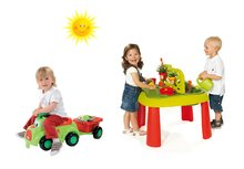 Set dětský stůl Zahradník De Jardinage 2v1 Smoby s plotem a odrážedlo s přívěsem a vědro setem od 2 let