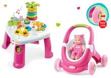 Komplet didaktična mizica Cotoons Smoby s funkcijami rožnata in voziček/sprehajalček 2v1 MiniKiss z dojenčkom