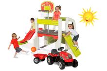 Set hracie centrum Fun Center Smoby so šmykľavkou dlhou 150 cm a traktor RX Bull s prívesom červený
