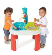 Gyerek asztal Víz&Homok 2in1 Smoby malommal, napernyőnyílással és 4 kiegészítővel 18 hónapos kortól