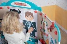Školní tabule - Lékařská ordinace s anatomií lidského těla Doctor's Office Smoby oboustranná s rentgenem a zrakovým testem a 65 doplňků_4