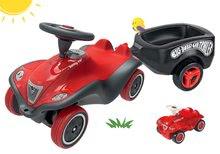 Szett bébitaxi autó Next Bobby Car BIG piros és fekete ovális utánfutó mini autóval