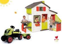 Komplet hišica Prijateljev Smoby s kuhinjo in zvoncem in traktor Claas Farmer s prikolico