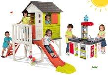 Szett gyermek házikó pilléreken Pilings House Smoby 1,5 m csúszdával és játékkonyha Tefal Studio XXL elektronikus bugyogással és jéggel 2 éves kortól